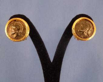 Gold Trojan clip earrings.
