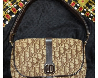 80's vintage Christian Dior brown trotter jacquard and leather combo handbag with the brown and gold tone CD motif.