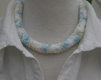 Pastel Necklace - fabric strips with lace bound round fleece inner embroidered with daisies