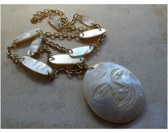 Mother Of Pearl Carved Moon Face Necklace 1960's