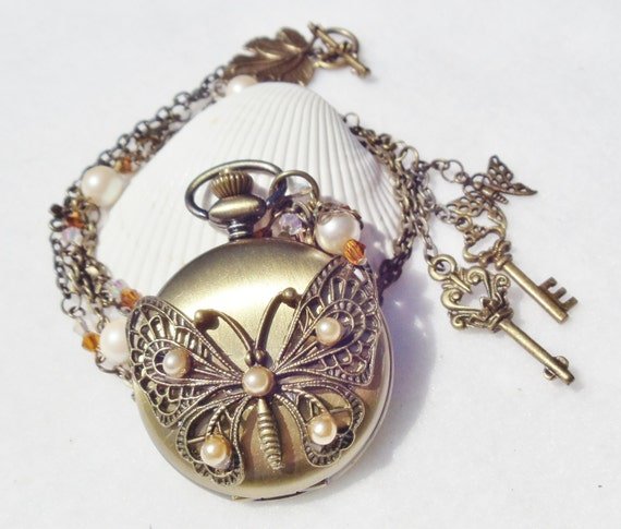 Butterfly watch pendant, pocket watch butterfly pendant with vintage glass pearls, Swarovski crystal  beads and bronze charms.