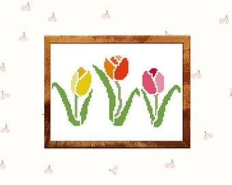 Tulip cross stitch pattern. Spring decorations. Trendy Tulip design, Flower decoration in yellow orange and red