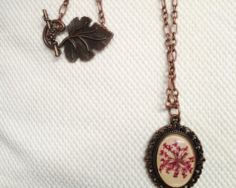 Unique pink gifts, Copper flower necklace in hot pink with real pressed flowers and glass cabochon over beige leather beautiful vine clasp