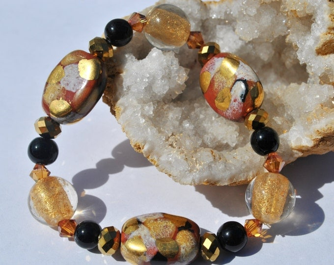 Autumn color ceramic bead and metallic accents stretch bracelet with Swarovski crystals