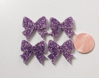 4x laser cut acrylic bow cabochons in Light Purple Glitter