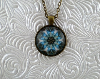 Turquoise blue and bronze abstract kaleidoscope pendant necklace