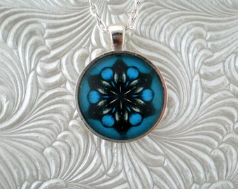 Intense blue, white and black abstract kaleidoscope pendant necklace