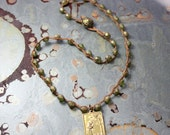 saint francis medal with czech beads necklace on waxed linen thread