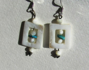 Mother of pearl dangles with a tiny hint of turquiose