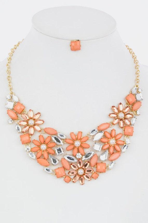 items similar to coral floral bib statement