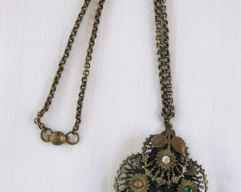 Brass necklace and large dimensional pendant with multi color rhinestones