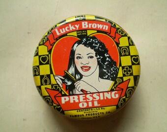 Lucky Brown Pressing Oil - Vintage Round Metal Tin - Circa 1930s 1940s - Chicago
