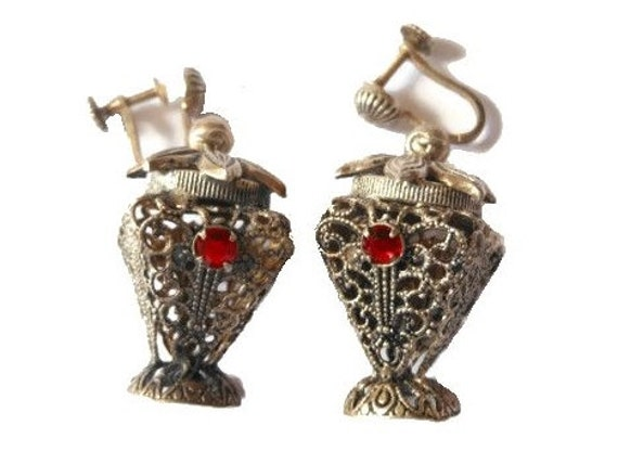 Art Nouveau earrings made in Austria finely detailed, intricate vase screw-back dangle earrings with ruby rhinestones in silver tone setting