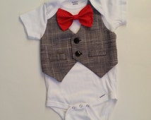 Baby Boy Bodysuit With A Vest Attached And Red Bow.