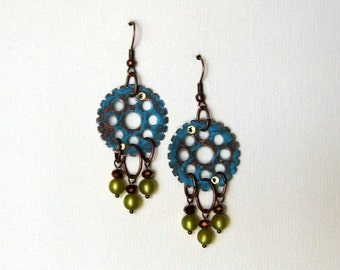 Patinaed and distressed chandelier earrings with olive vintage cats eye beads