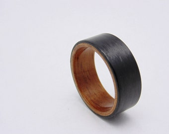 Carbon Fiber ring with Golden Hawaiian Koa bentwood liner