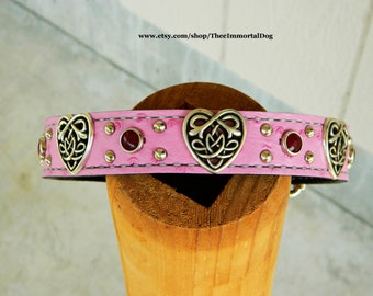 The Roxy is a 1.25'' custom collar adorned with celtic heart concho's and cranberry red gems Held Together With Chicago Screws.