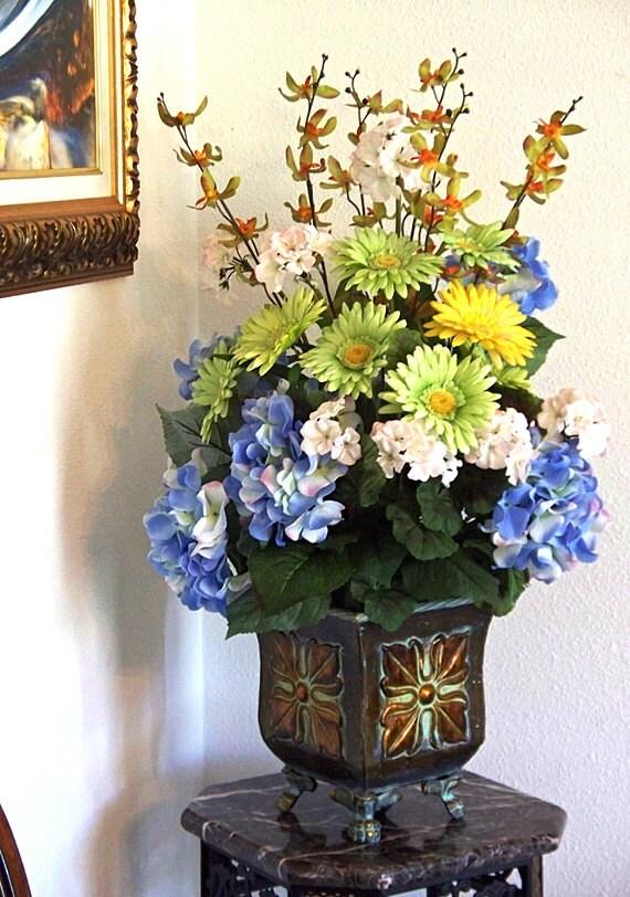 Hydrangea gerbera floral centerpiece urn gold vase