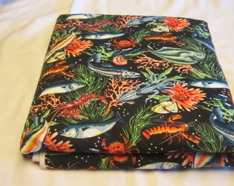 3 yards 60 inch wide ocean themed upholstery weight fabric with fish, lobster, squid, seaweed.