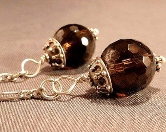 Princess crystal ball earrings grey smokey quartz crystals hanging from sterling silver chains