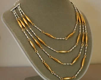 Mixed Metal Gold and Silver Plated Fancy Link Four Strand Necklace