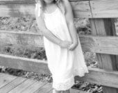 Beautiful  fully lined white beach portrait dress with lace trim for girls sizes 0-12