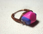 Pink and purple faceted clay bead wrapped copper ring