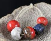 Handmade stoneware ceramic beads Red, White, and Blue (5)