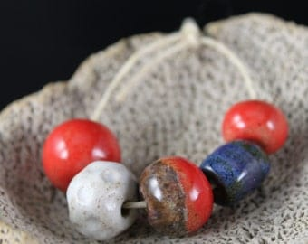 Handmade stoneware ceramic beads Red, White, and Blue (5)