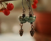 Artisan glass lampwork bird earrings ... Copper green and pine cones...made to order...by Simply Cindy