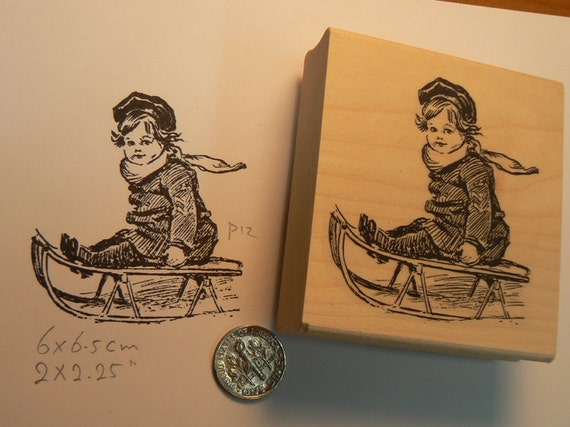 Boy on sled rubber stamp WM P12