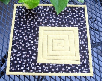 Table mat or mug rug, black and yellow, quilted, 8 3/4 x 8 3/4