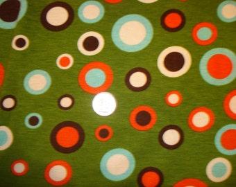 Polka dots on green poly rayon lycra knit blend 1 YD