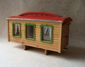 this is reserved for qwynyth .   vintage painted wood toy caravan or camper with curtains doors and sliding awning