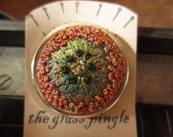 Copper coloured Anenome brooch