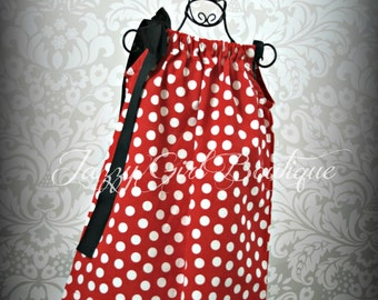 Girls Pillowcase Dress Red with White Polka Dots with a Large Black Bow at One Shoulder. Sizes 6mo - 5T.  Sizes 6-8 Three Dollars More