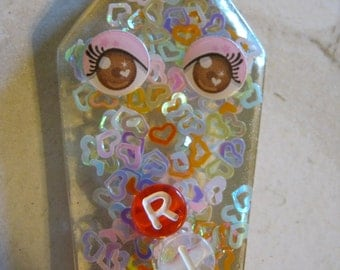 Eyes and SIlver Sequin Hearts Coffin Resin Cabochon