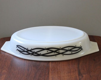 Barbed Wire. Vintage 1958 Promotional Pyrex divided Cinderalla oval casserole.