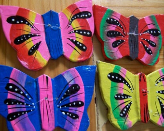 colorful painted wooden butterflies