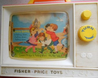 Vintage Fisher Price Carry with you TV Musical Toy Picture moves across screen