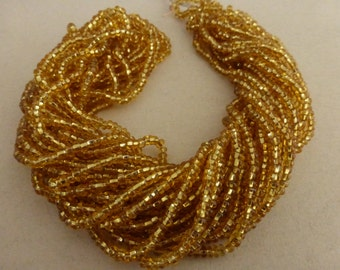 Vintage  Gold Silver Lined Glass Seed Beads  Hank of 11 Strands