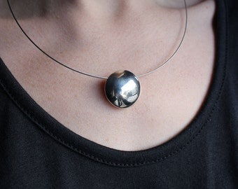 Contrast Pendant,  Sterling silver and copper , Forged geometric cupped disc, sphere.