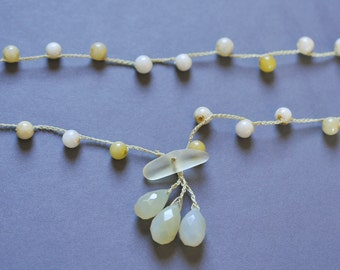 Pale chalcedony cluster crocheted necklace with snow quartz strand and beach glass front toggle closure