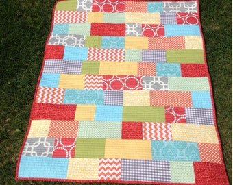 Bright Bricklayer crib size quilt