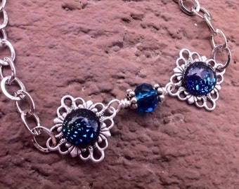 Blue dichroic glass bracelet in antique silver plated filigree