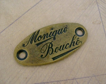 Super Swanky 1980s Vintage Brass Monique Bouche Clothing Tag