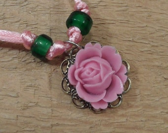 Rose necklace dusty pink resin rose green glass beads