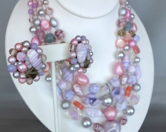 Vintage multi strand pink and purple glass beaded necklace with matching cluster clip on earrings