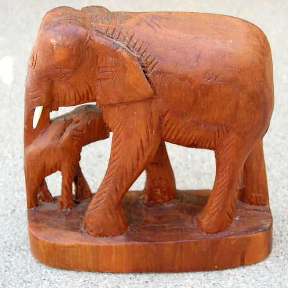 Items similar to vintage wood carving elephants african