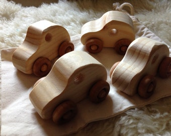 4 little wooden cars in a sack